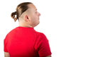 A man in a red shirt with a fashionable hairstyle is back Stock Images
