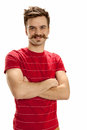 Man in red striped shirt handsome young with crossed arms standing and smiling isolated on white background Royalty Free Stock Photo