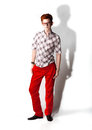 Man in red trousers handsome posing against white background Royalty Free Stock Images