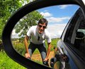 Man reflected in car mirror reflection of a a on a summer day Stock Photography