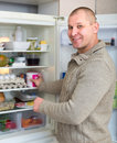 Man and refrigerator Royalty Free Stock Photo