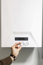 Man regulate power heating boiler control panel Royalty Free Stock Photo