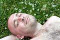 Man relax over green meadow Stock Image