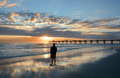 Man relaxing on the beautiful beach at sunrise. Royalty Free Stock Photo