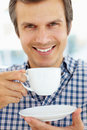 Man relaxing with cup of tea Royalty Free Stock Photography