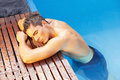 Man relaxing at edge of pool Royalty Free Stock Images