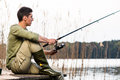 Man relaxing fishing or angling at lake Royalty Free Stock Photo
