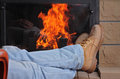 Man relaxing at home near fireplace winter holiday concept lumberjack shoes style Royalty Free Stock Photos