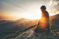 Man relaxing at sunset mountains Travel Lifestyle Royalty Free Stock Photo