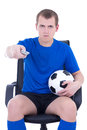 Man with remote control watching football game isolated on white Royalty Free Stock Images