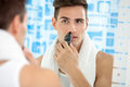 Man remove hair from his nose handsome young with trimmer Stock Photo