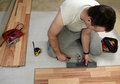 Man renovating a floor Stock Images