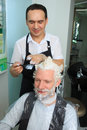 Man repaint the hair in a beauty salon Royalty Free Stock Photo