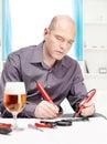 Man repairing an electronic device Stock Photos