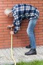 Man repairing leaky garden hose spigot Royalty Free Stock Photo