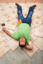 Man resting on ceramic floor tiles he is installing top view Stock Photography
