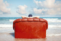 Man resting in couch on the beach Royalty Free Stock Photo