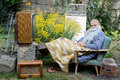 Man resting garden Stock Images