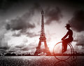 Man on retro bicycle next to Effel Tower, Paris, France. Royalty Free Stock Photo