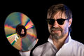 Man with the retro laser disc Royalty Free Stock Image