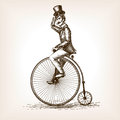 Man on retro vintage old bicycle sketch vector Royalty Free Stock Photo