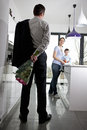 A man returning home to his family after work, holding a bunch of roses Royalty Free Stock Photo