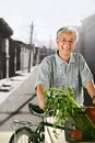 Man ride to shopping oriental senior Stock Image