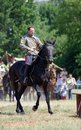 A man rides a black horse. Horse riders competition