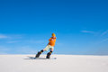 Man rides on the snowboard in desert Royalty Free Stock Photo