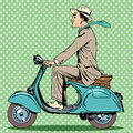 Man rides on a vintage scooter Royalty Free Stock Photo