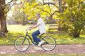 Man riding bicycle handsome mid age at the park Royalty Free Stock Image