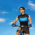 Man Riding a Bike on Blue Sky Background Royalty Free Stock Image
