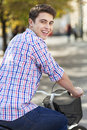 Man riding a bike in the city portrait of young smiling Royalty Free Stock Photo