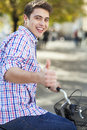 Man riding a bike in the city portrait of young smiling Stock Photos