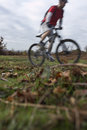 Man riding bike on countryside blurred motion of mountain Royalty Free Stock Photography