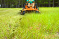 Man riding lawnmower Royalty Free Stock Photography