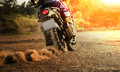 Man riding sport touring motorcycle on dirt field Royalty Free Stock Photo