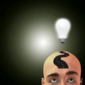 Man with road atop head and light bulb Stock Photos