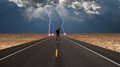 Man On Road Before Storm