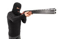 A man with robbery mask attacking someone with shotgun Royalty Free Stock Photos