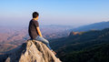 Man on rock at mountain Royalty Free Stock Images