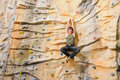 Man on rock wall in sport center Royalty Free Stock Photography