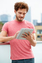 Man on roof terrace using digital tablet close up of Royalty Free Stock Image