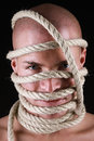 Man with rope on his head portrait of a Stock Image
