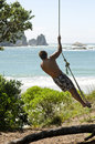Man on rope swing Royalty Free Stock Photography