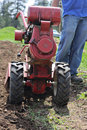 Man rototilling garden. Stock Photo