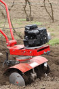 Man rototilling garden Stock Images