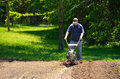 Man rototilling the garden Royalty Free Stock Photo