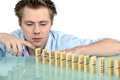 Man with a row of dominoes Royalty Free Stock Photography