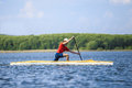Man rower in a canoe rowing Royalty Free Stock Photo